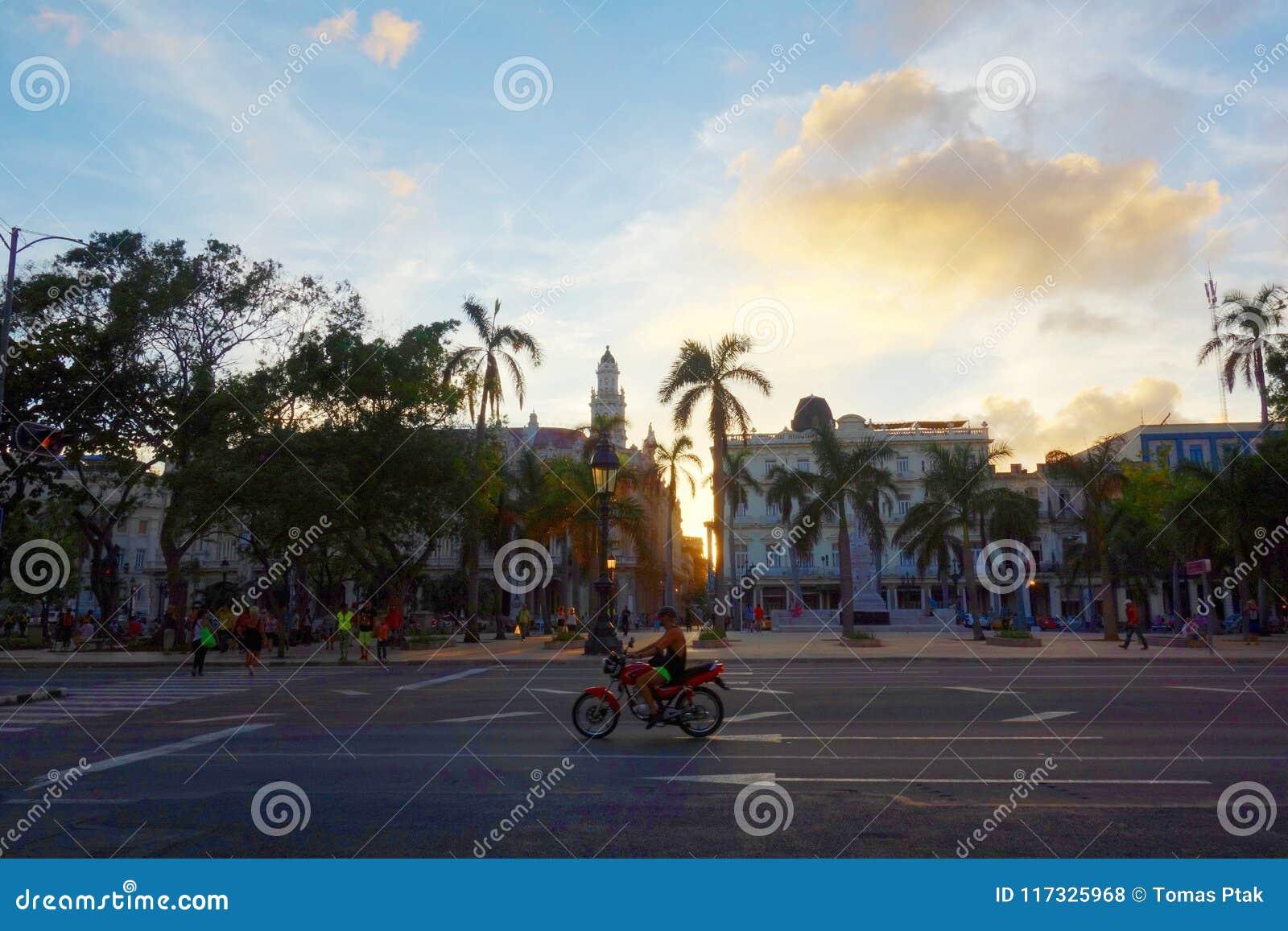 Colorful colonial buildings with motorbike, Havana, Cuba