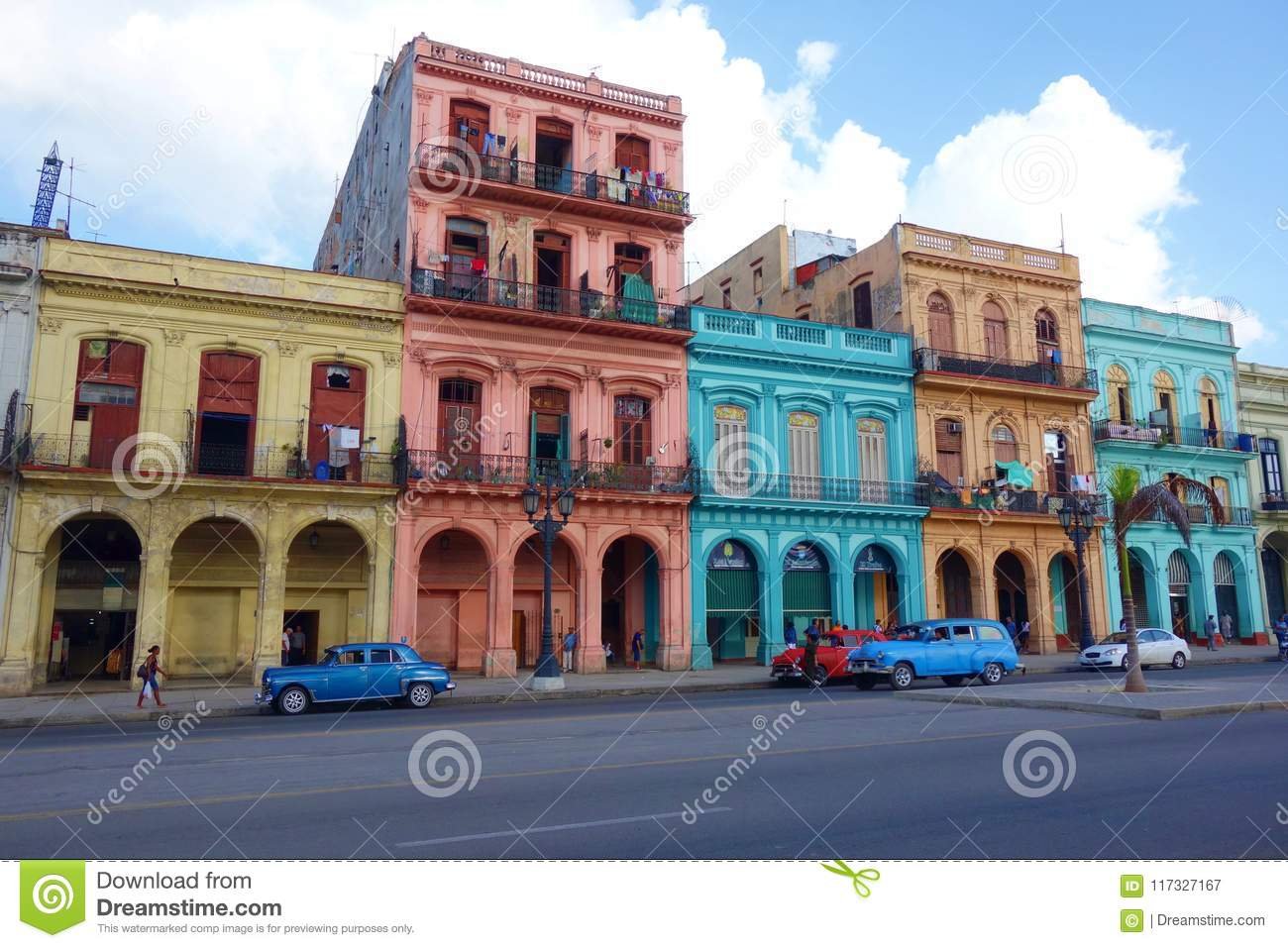 Colorful colonial buildings with old vintage cars, Havana, Cuba