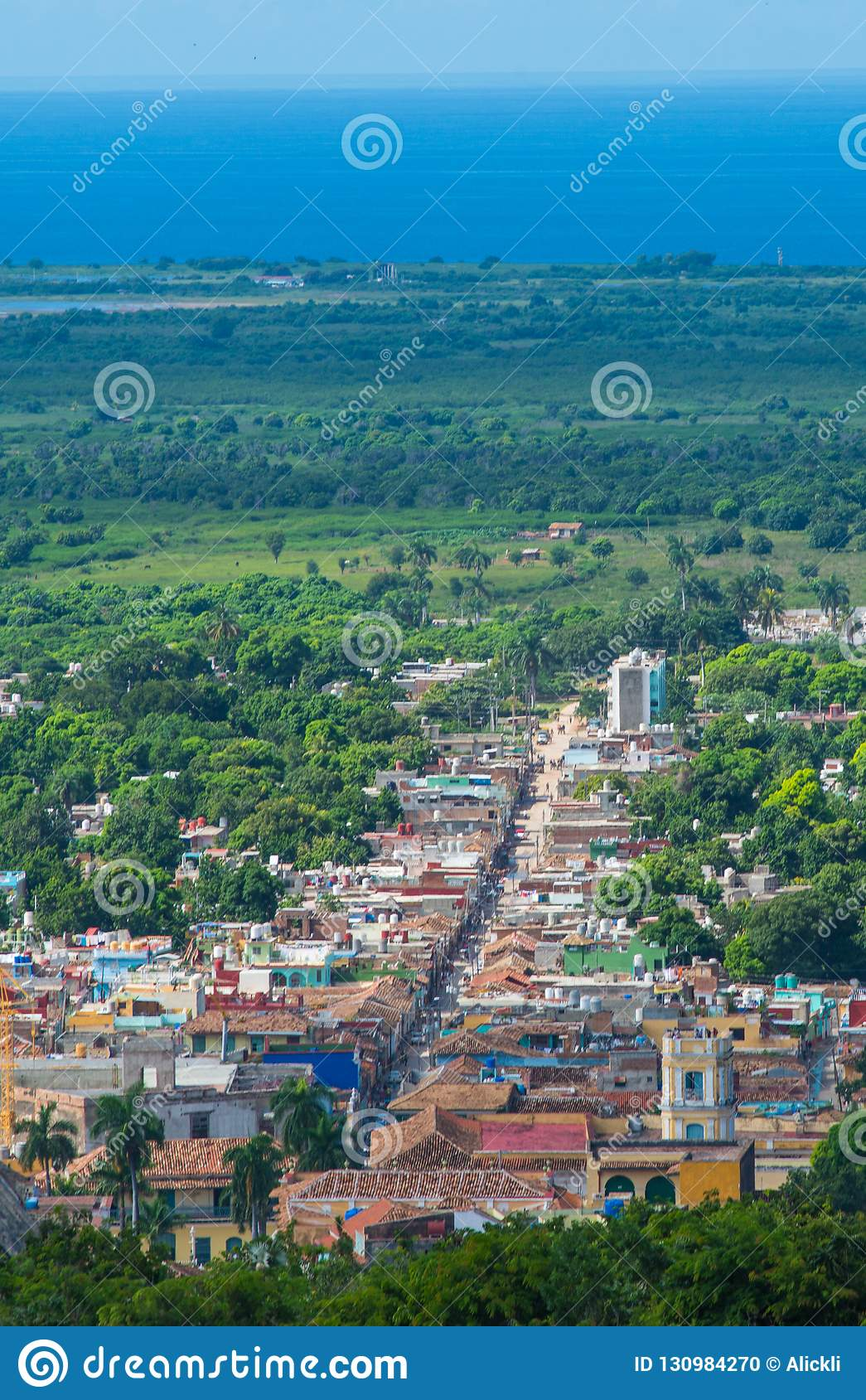 Colorful Colonial Caribbean street overlook with classic building and house, Trinidad, Cuba, America.