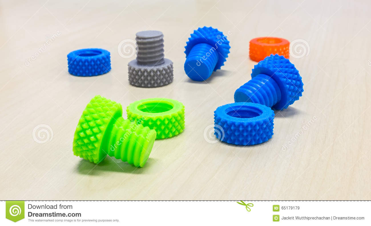 Colorful Creative Plastic Nuts Bolts and Rings made by 3D Printer on Wooden Table