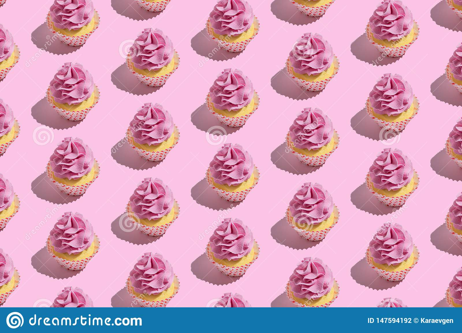 Colorful cupcake pattern on pastel pink background. Creative minimal party concept