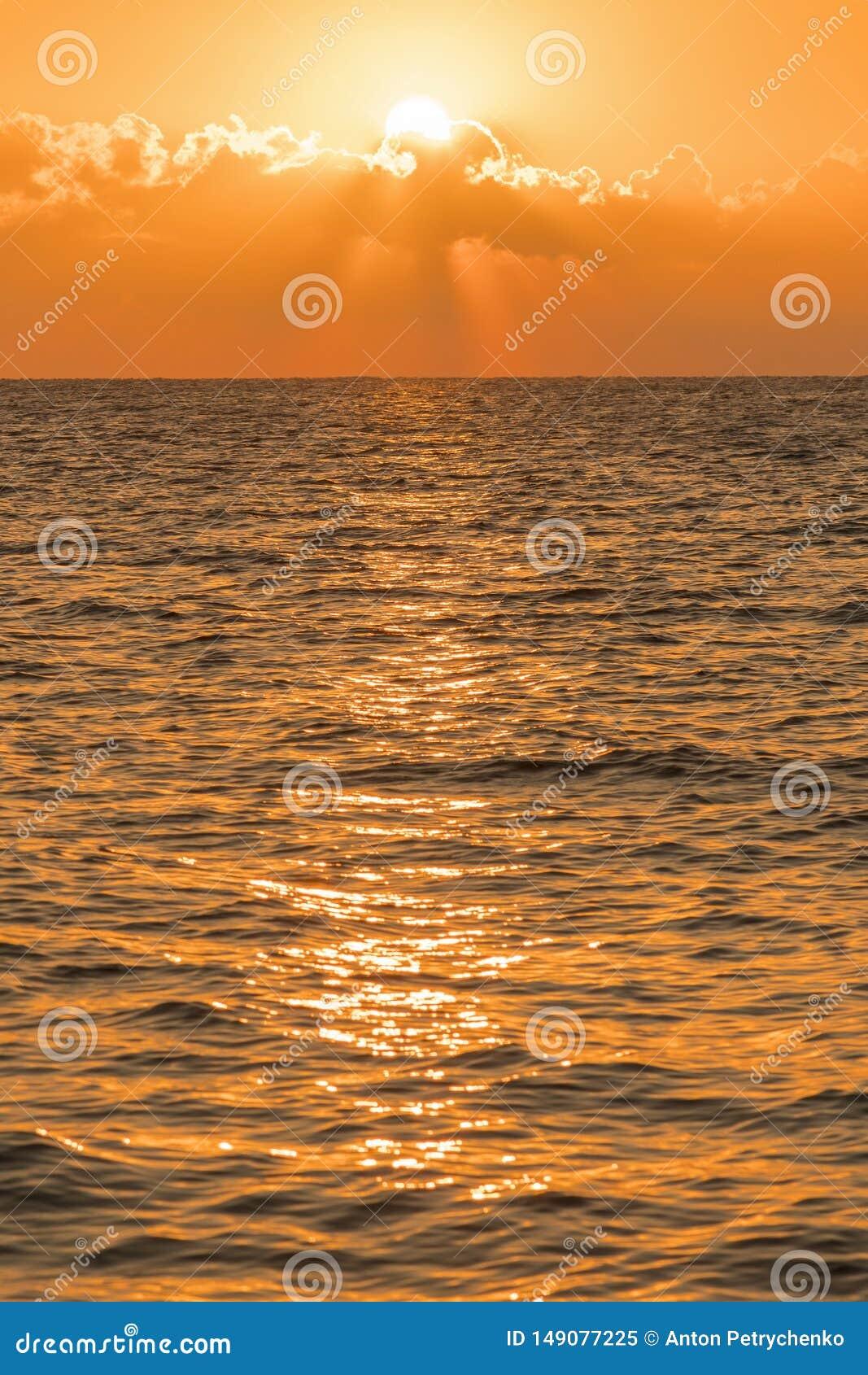 Colorful dawn over the sea, Sunset. Beautiful magic sunset over the sea. vertical photo