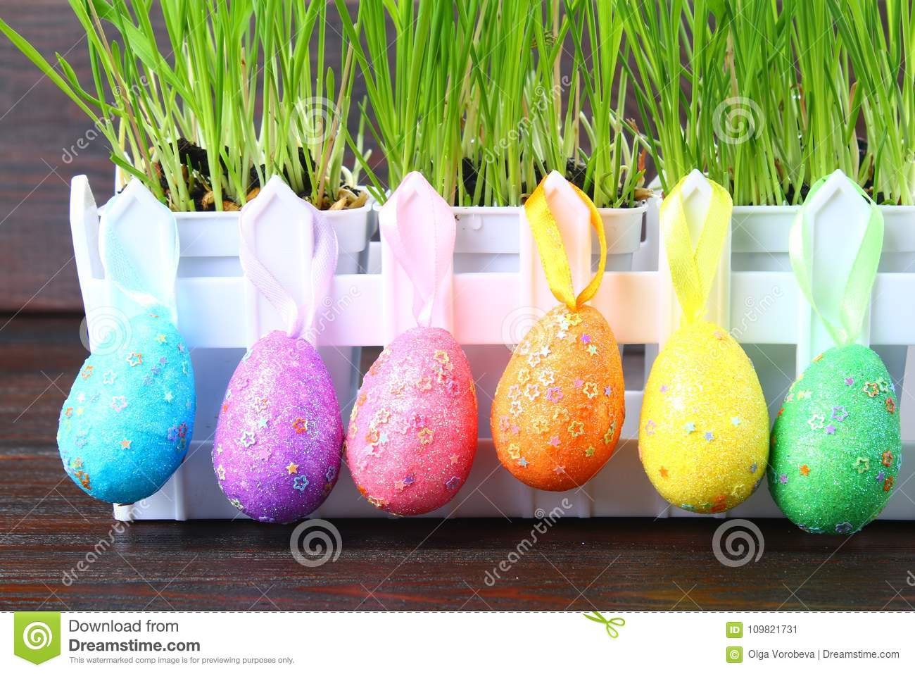 Colorful decorative eggs of rainbow colors on a background of green grass. Easter.