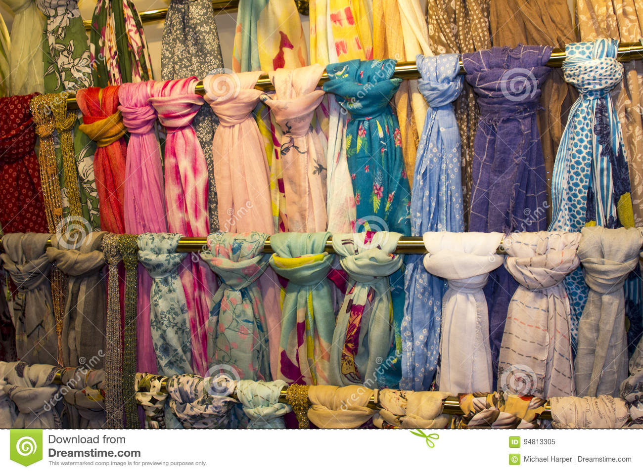 A Colorful Display Of Fashionable Ladies Scarves On Hanging Rails ...