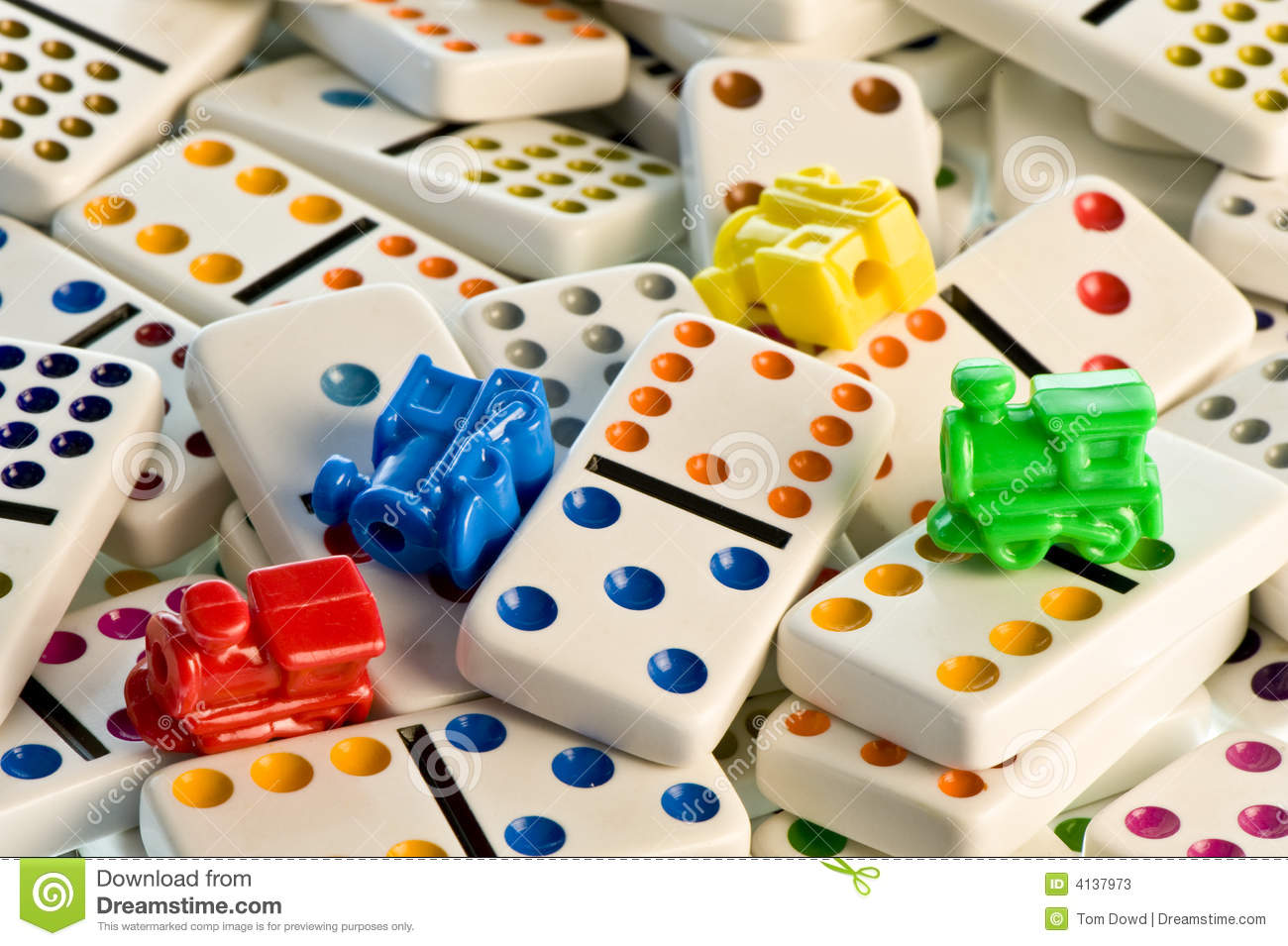 Closeup Of Colorful Plastic Dominoes And Train Locomotives Used In A