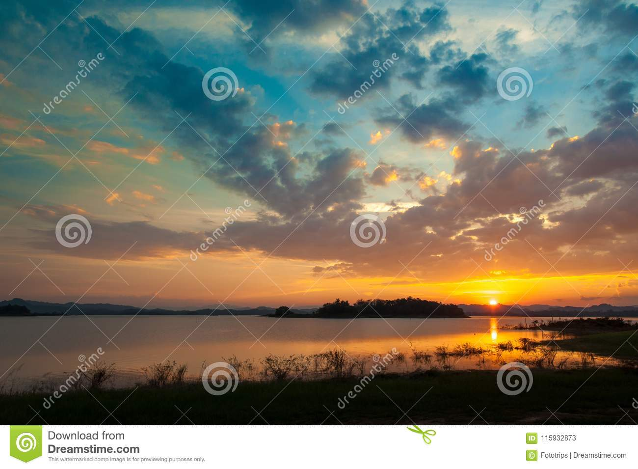 colorful dramatic sky with cloud at sunset. over silhouette mountains