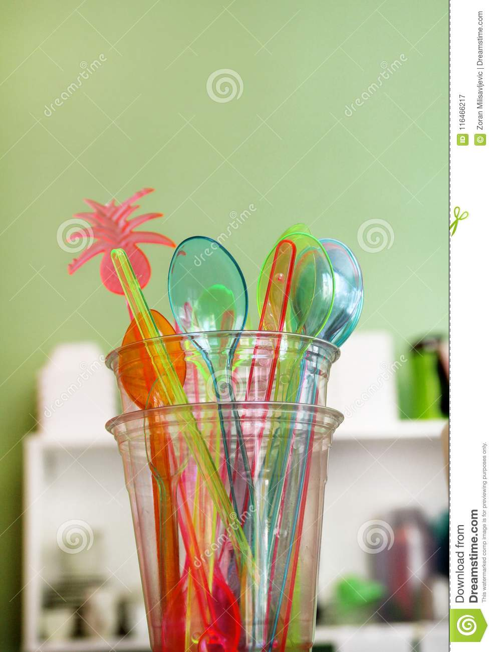 Colorful Drinking Straws In Glass, Plastic Spoon And Plastic