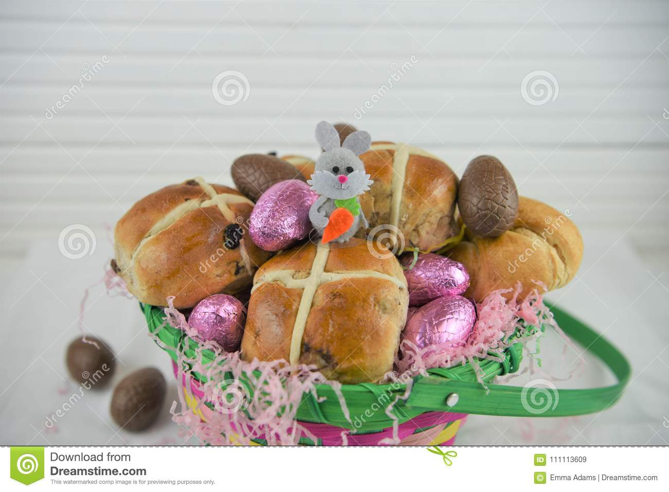 Cute easter basket gift filled with chocolate eggs and easter bunny royalty free stock photo negle Gallery