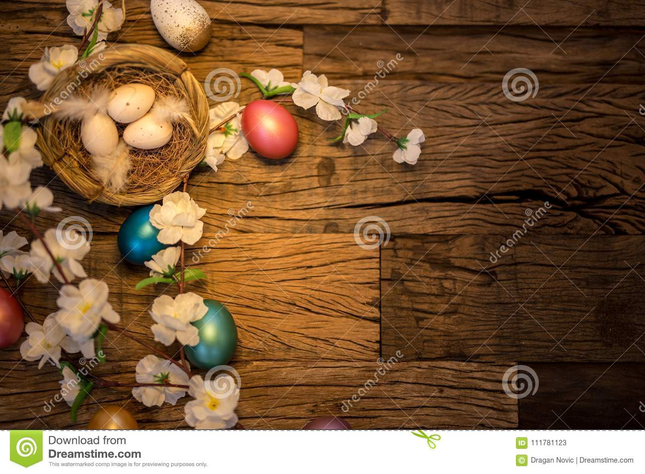 Colorful easter decoration on a wooden background