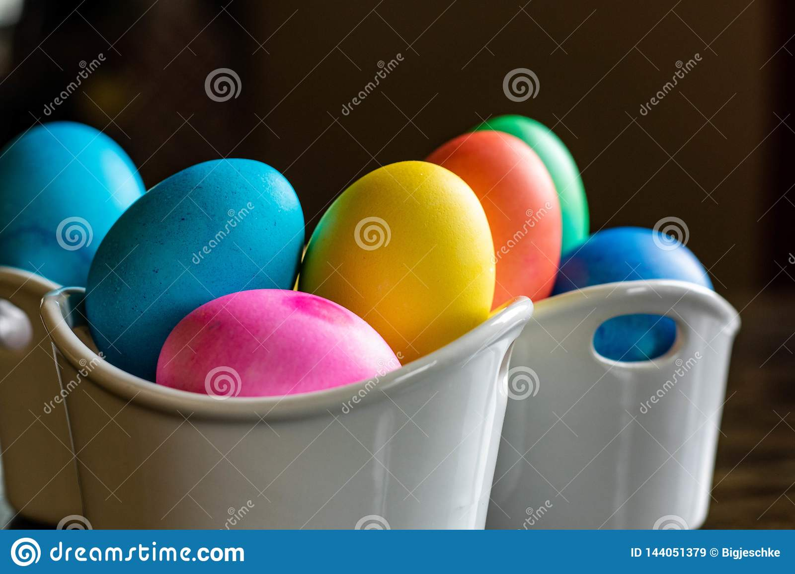 Colorful Easter egg arrangement in white bowls