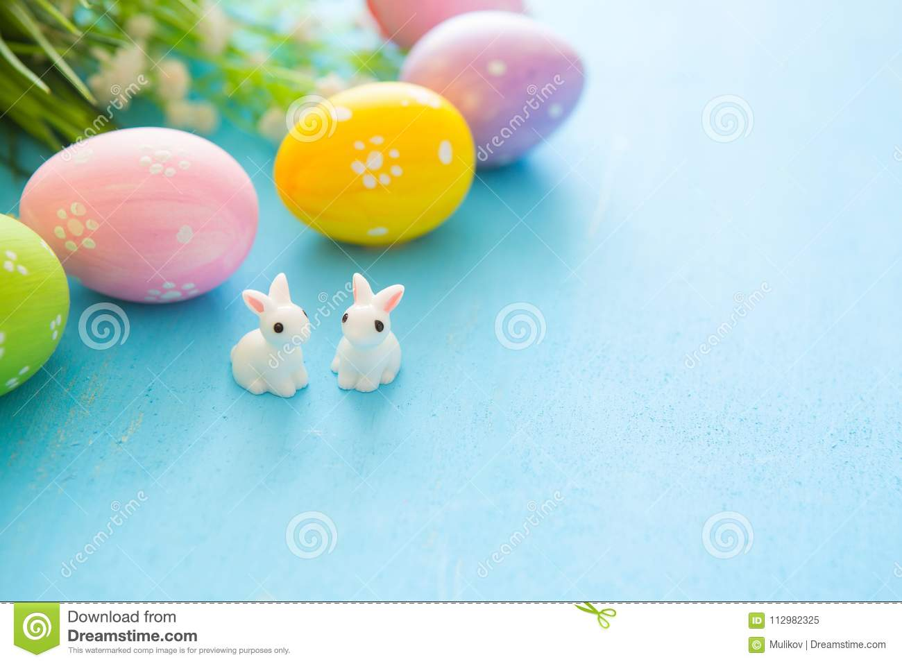 Colorful easter egg on blue pastel color wood background