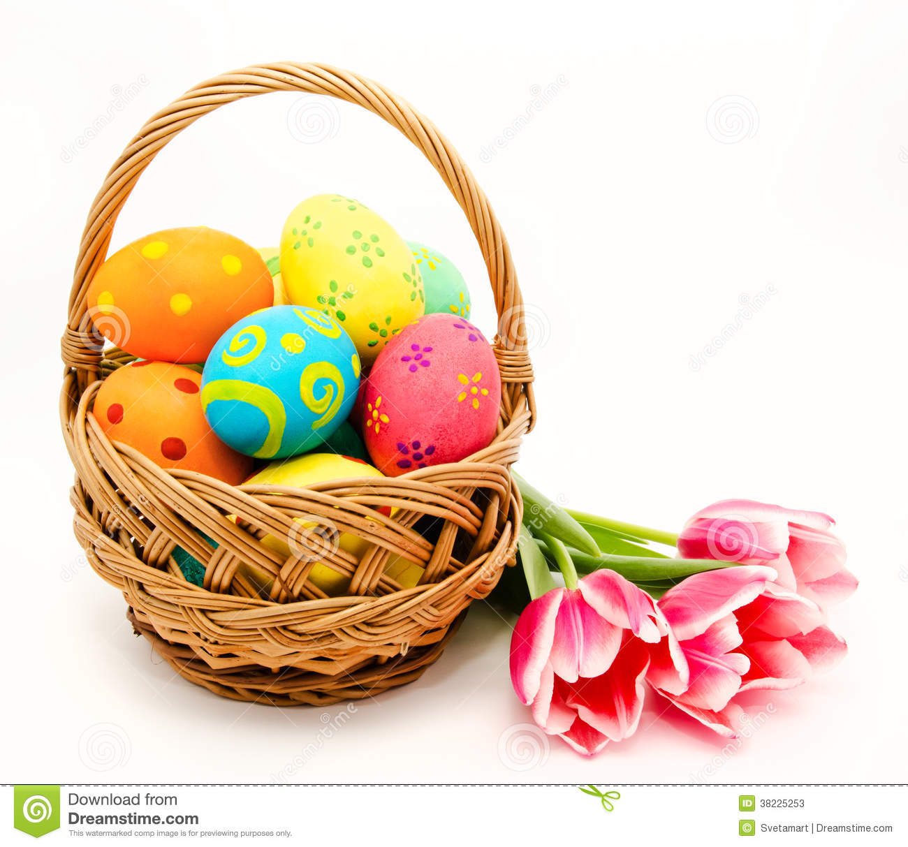 Stock Photos: Colorful easter eggs in basket and flowers isolated on a ...