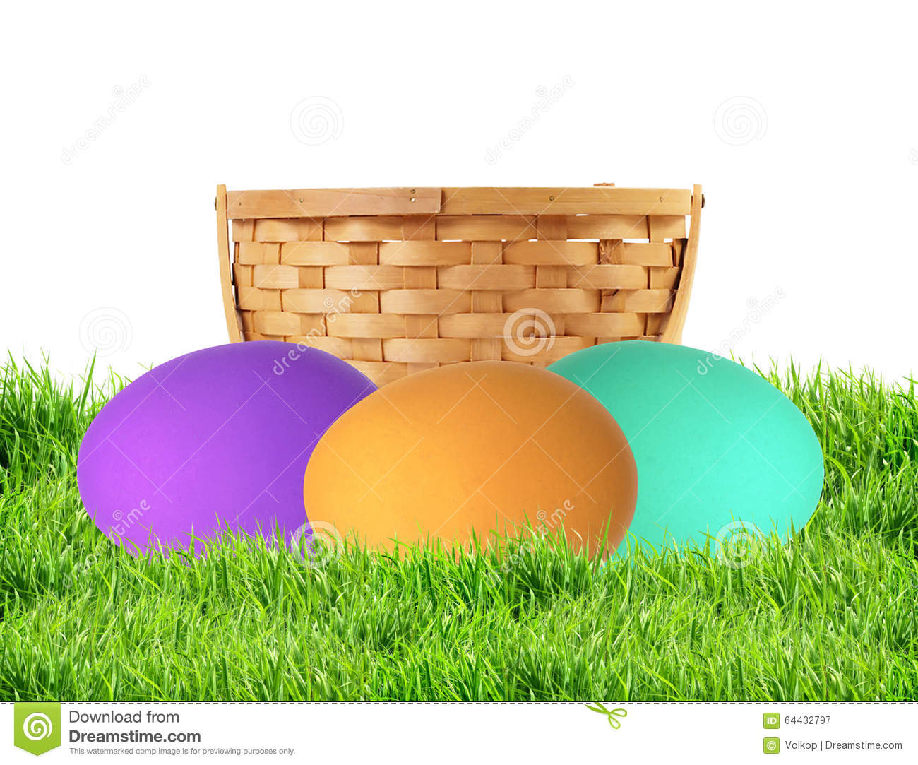 Colorful Easter Eggs in green grass isolated on white