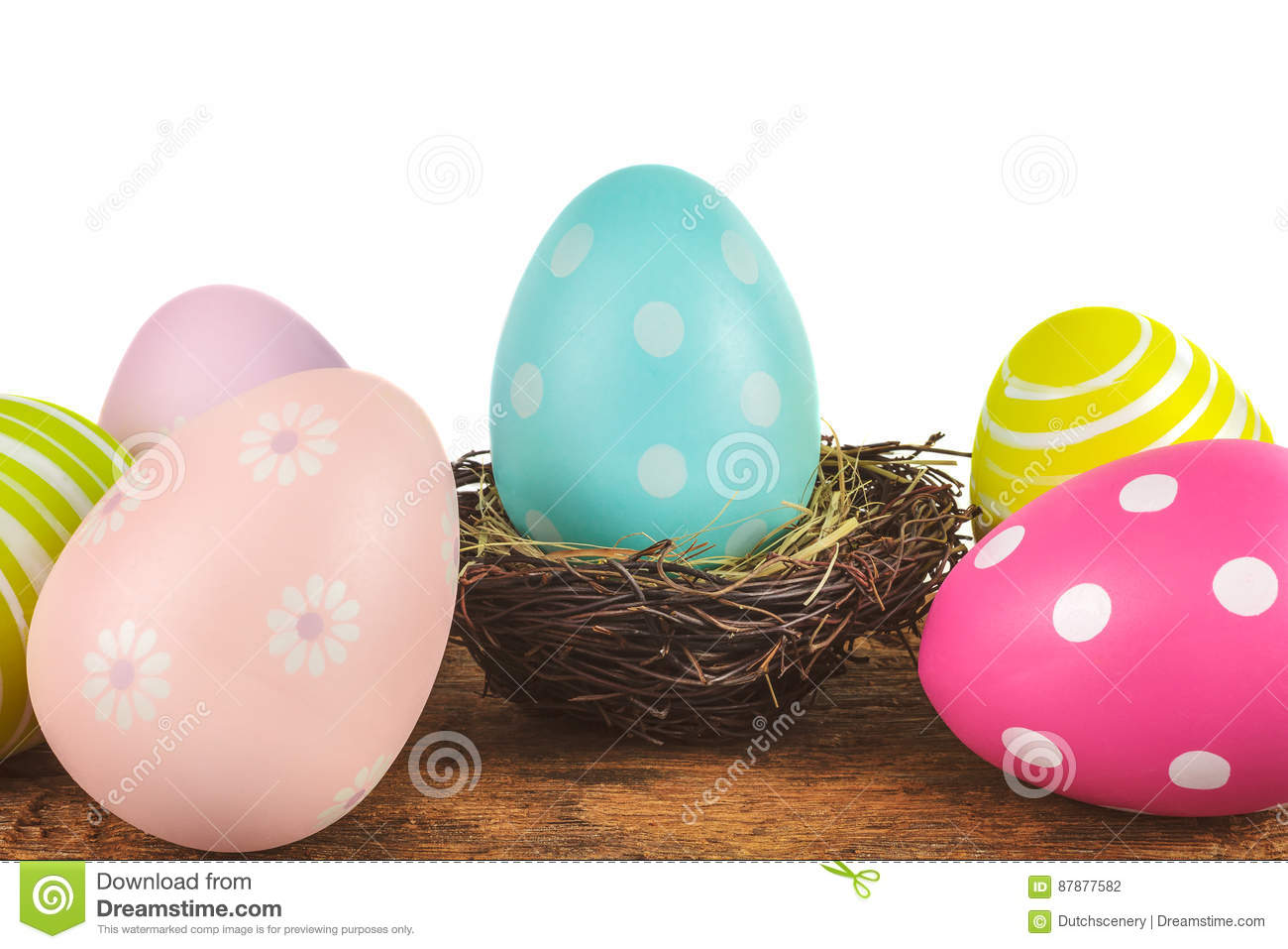 Colorful easter eggs on a wooden table isolated on white