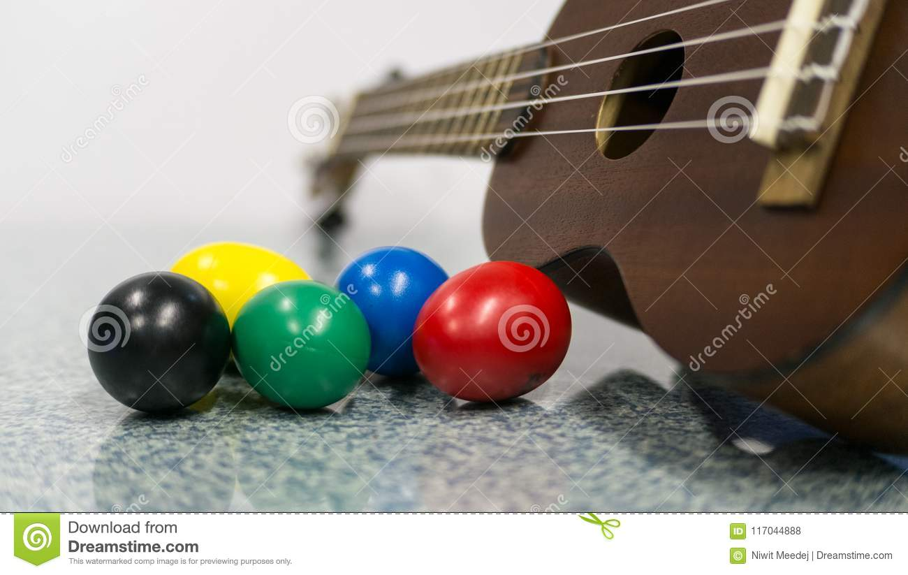 Colorful egg shakers with Dark Brown Ukulele.