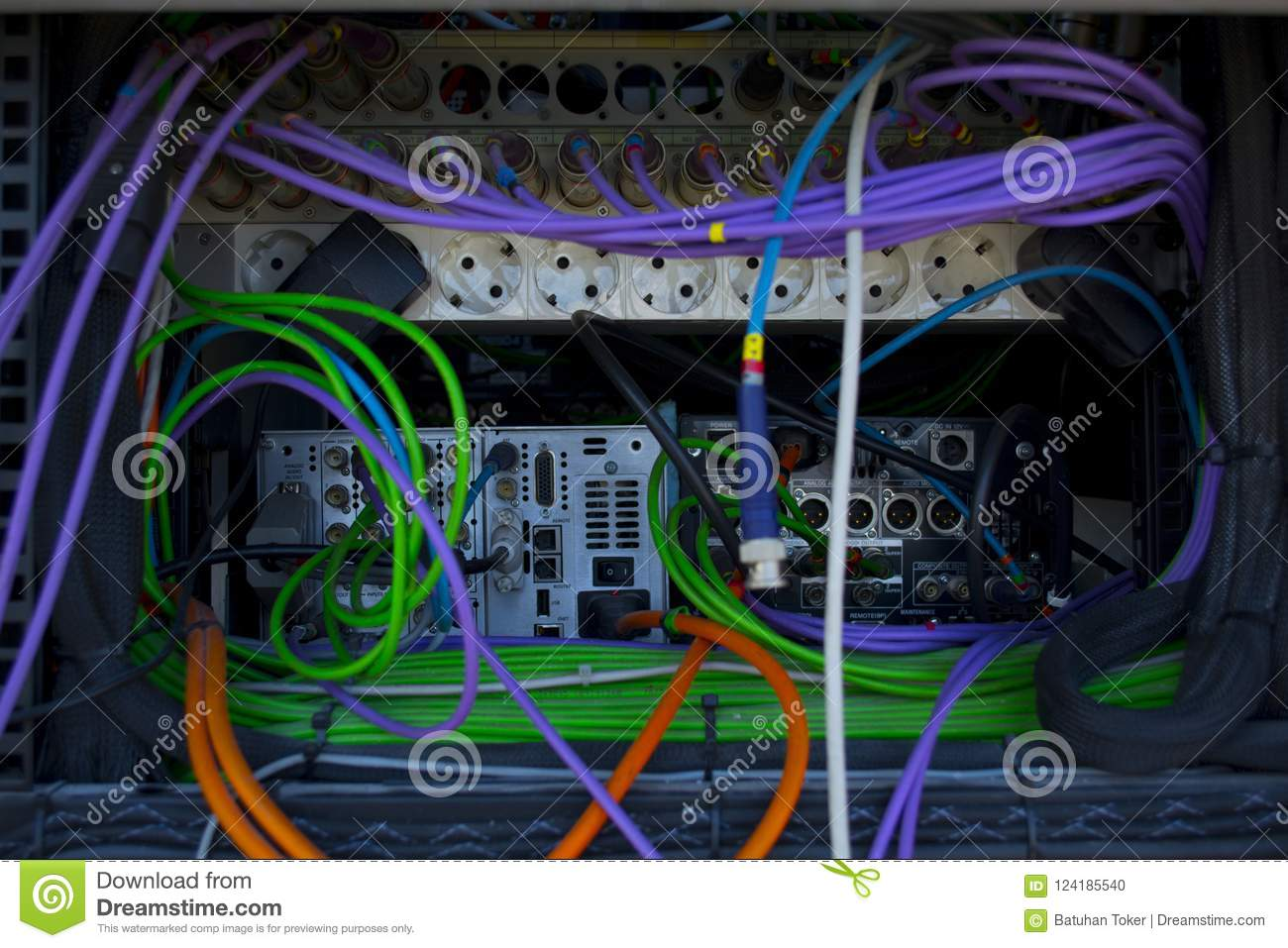 Colorful electric cables. Installing electrical cables into broadcasting equipment and power supply boxes. Hardware for TV broadca