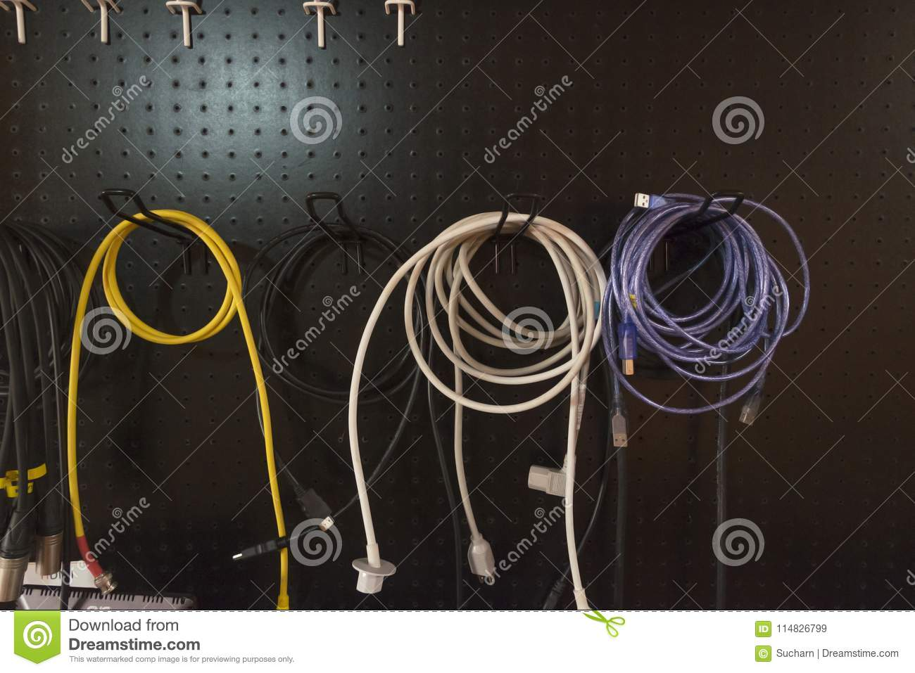 Colorful Of Electric Wire Hanging On Storage Rack On Black Backg ...