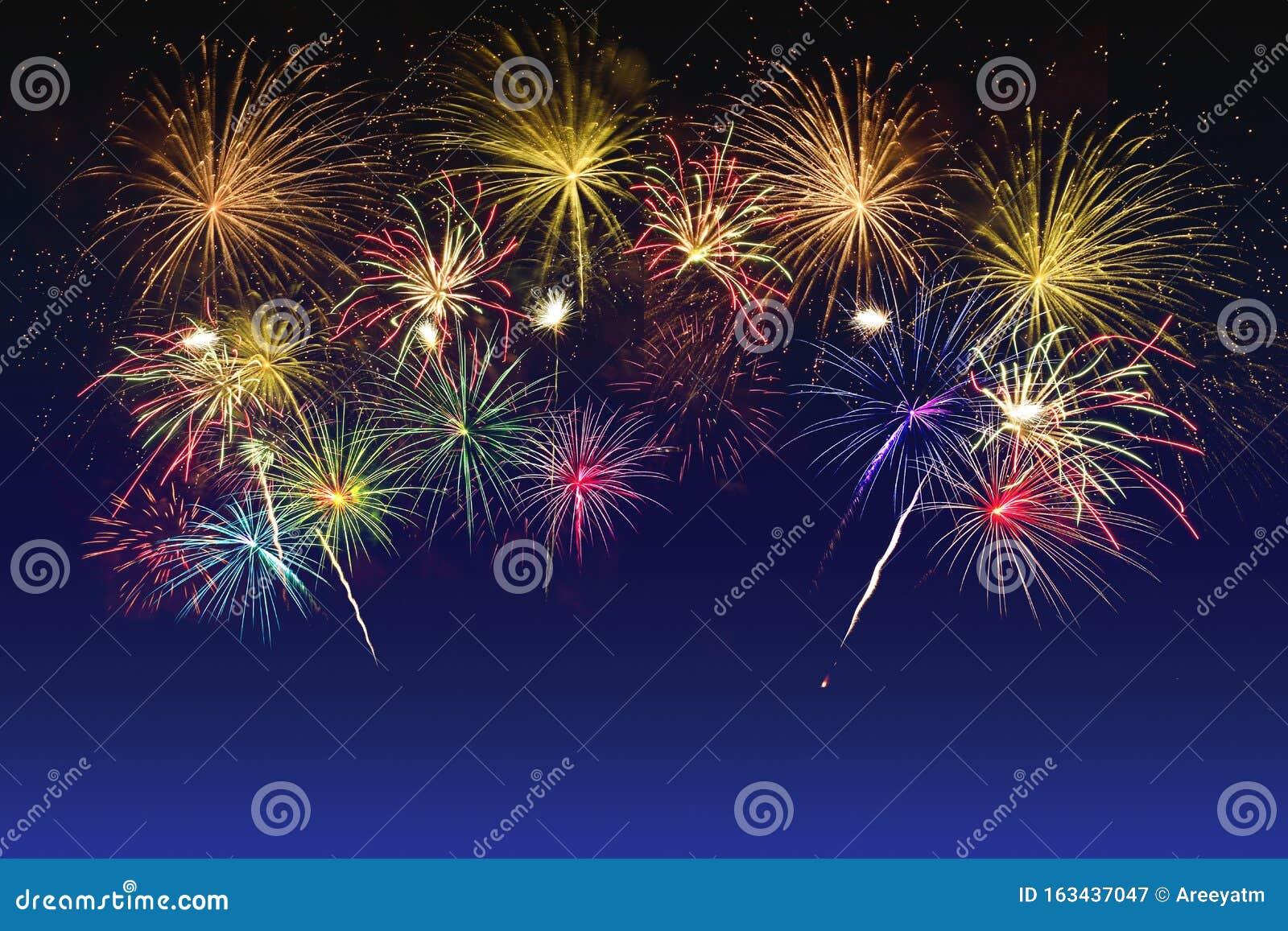 Colorful fireworks celebration on twilight sky