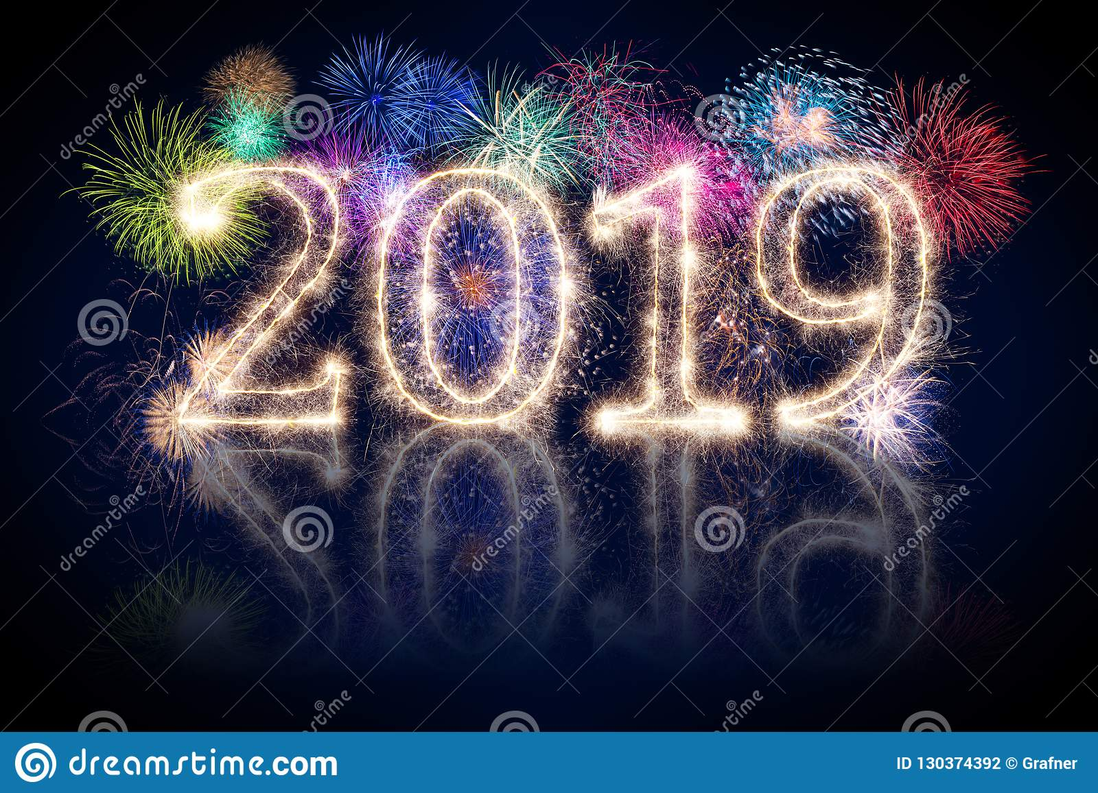 colorful fireworks display and bright sparkler pyrotechnic number 2019 happy new year