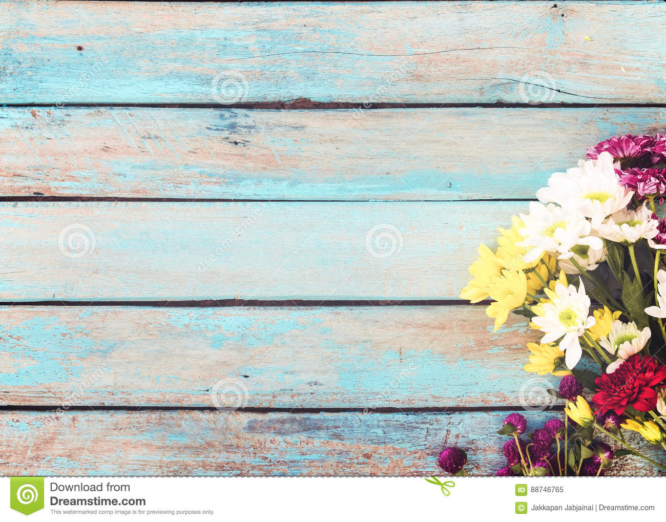 colorful flowers bouquet on vintage wooden background