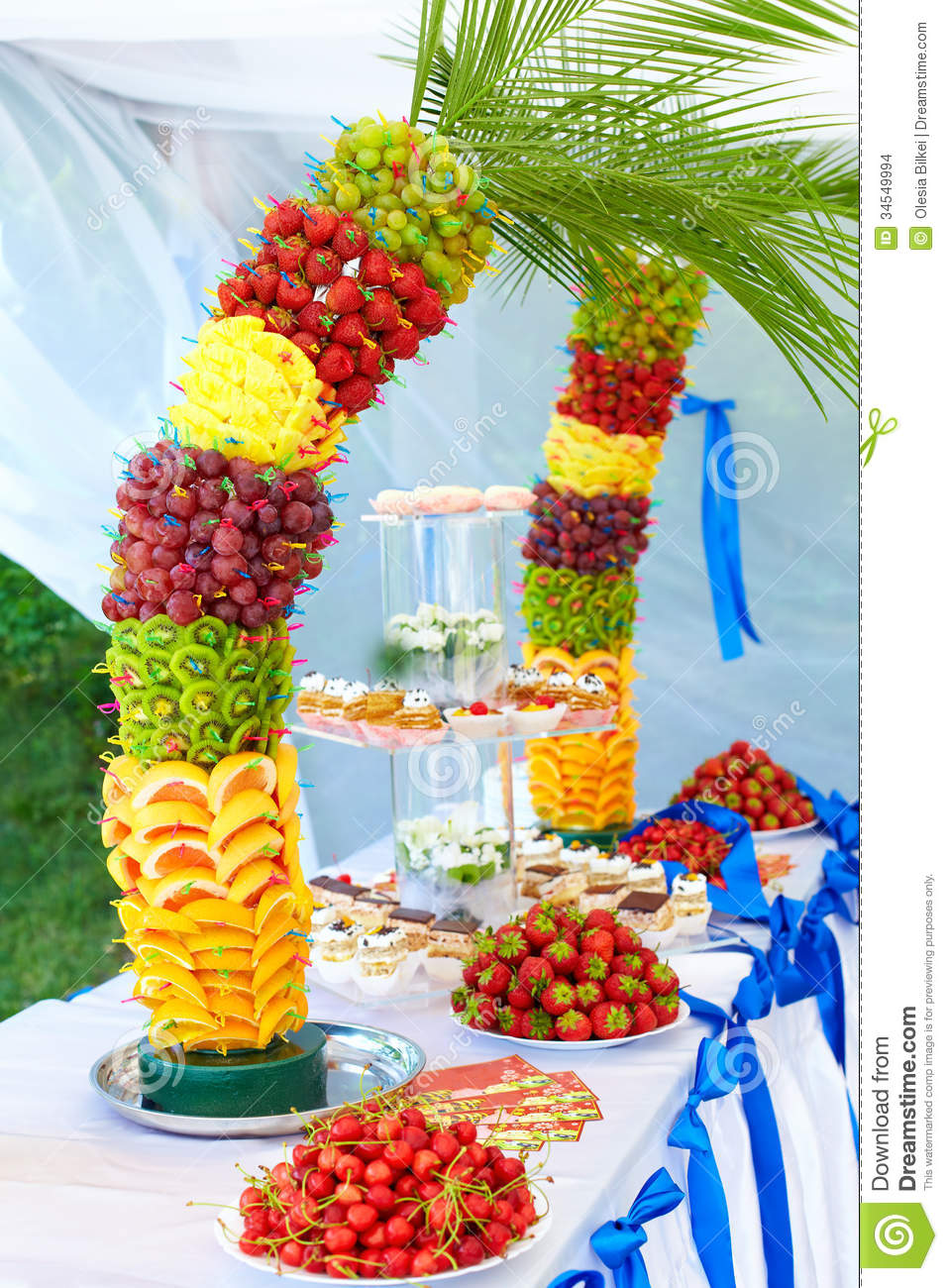 Colorful fruit and cake decoration on banquet party stock for Apples for decoration