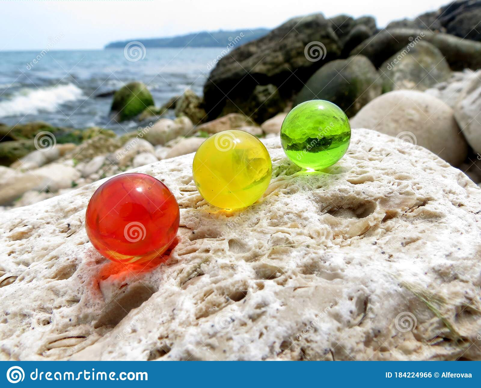 Colorful Glass Marbles On The Beige Rock Near The Sea Summer Mood Positive Start Of The Day Stock Photo Image Of Mood Sunny 184224966