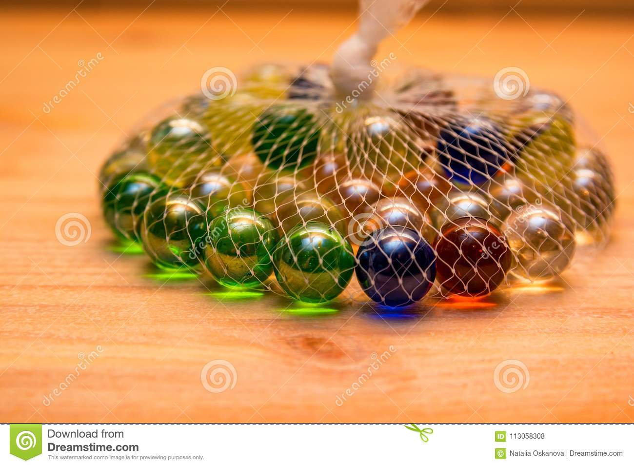 Colorful Glass Marbles In Net Stock Photo Image Of Heap Pack