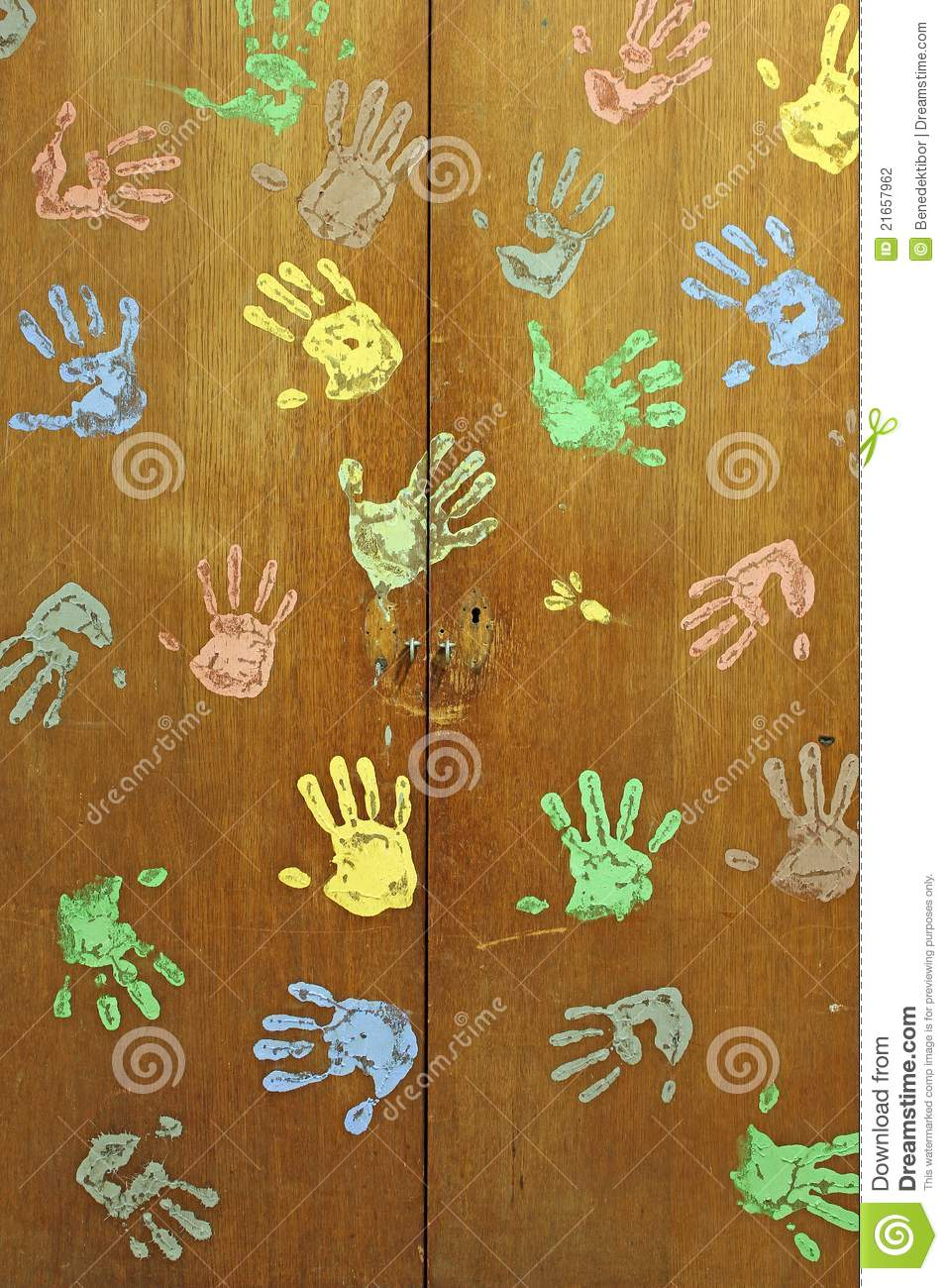 Colorful hands on wardrobe