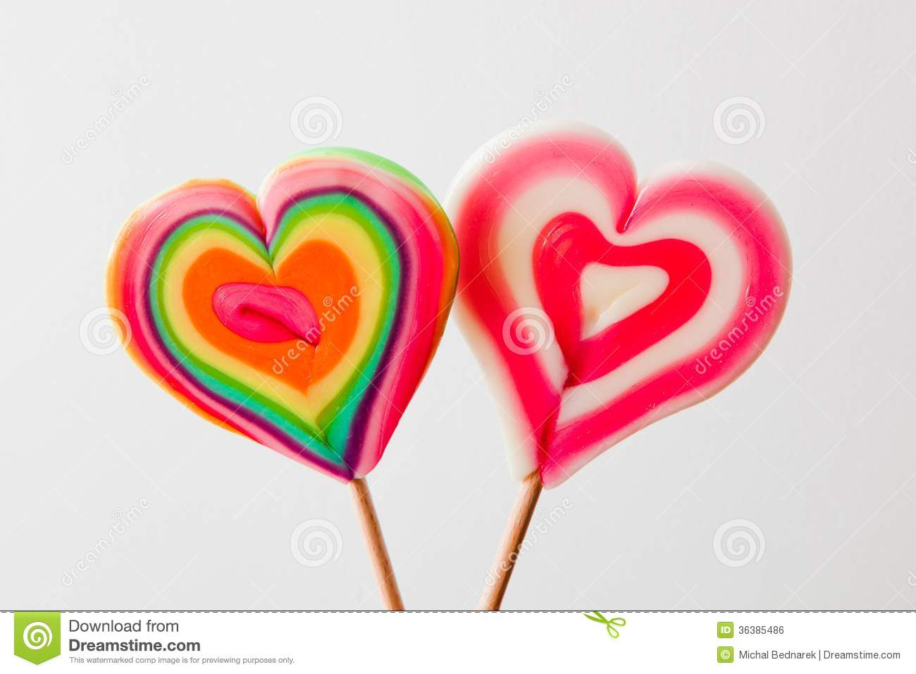Colorful Heart Shaped Lollipops On Grey Background Royalty