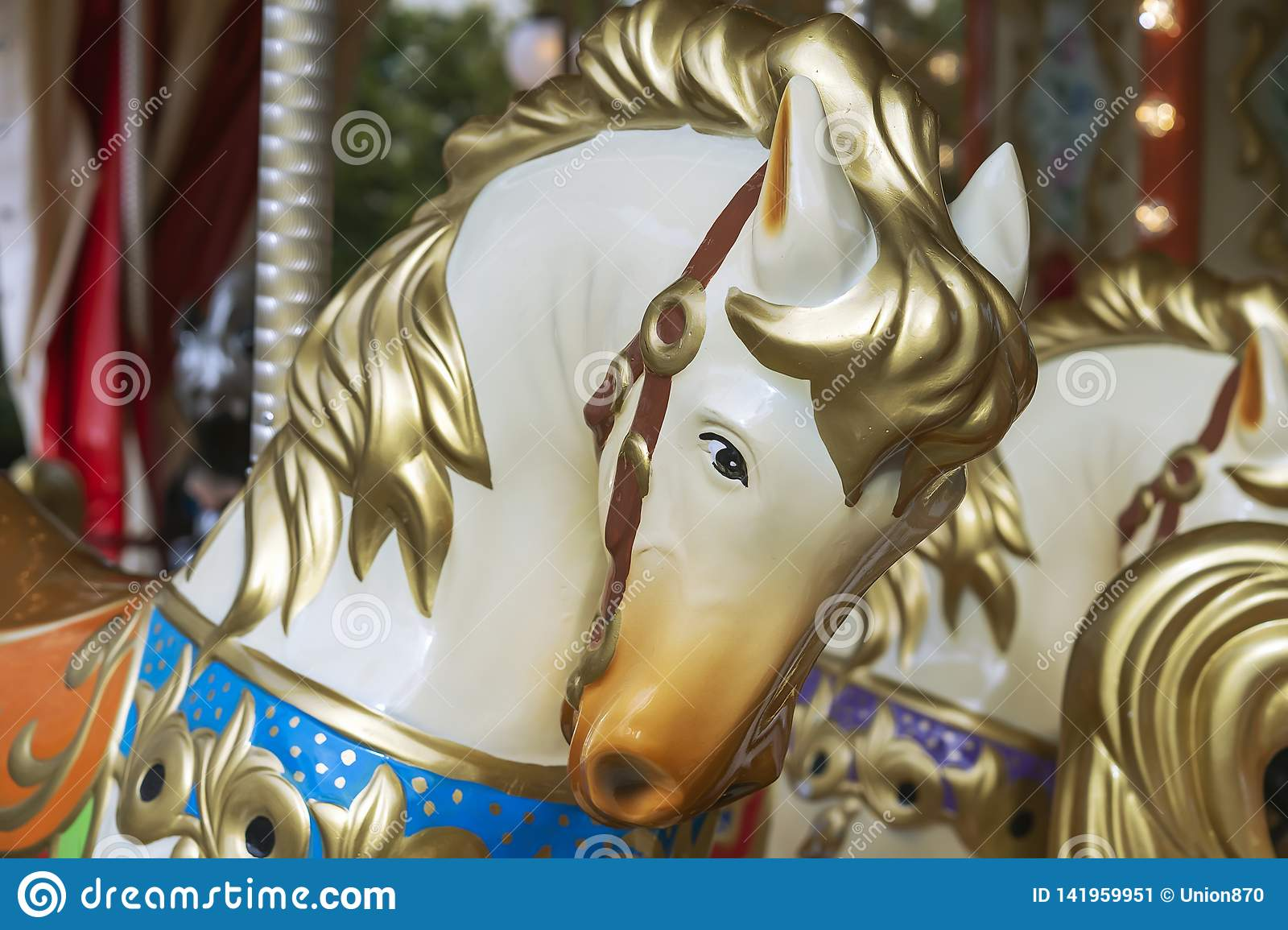 Colorful horse head on a vintage circular merry-go-round