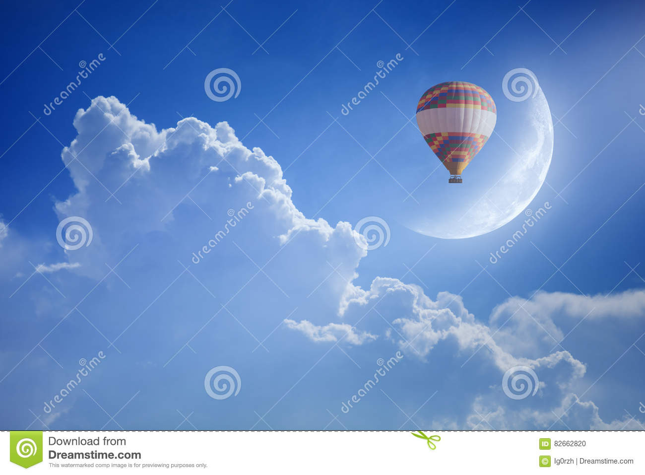 Colorful hot air balloon rise up into blue sky above white cloud
