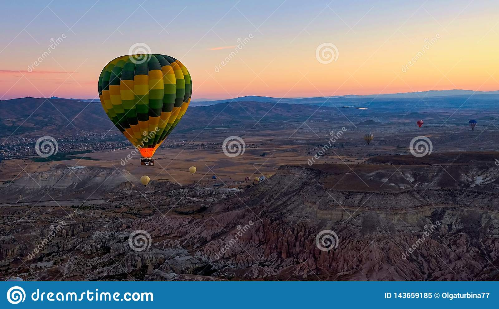 Colorful hot air balloons soaring over the valley at sunrise. Cappadocia,Turkey, autumn