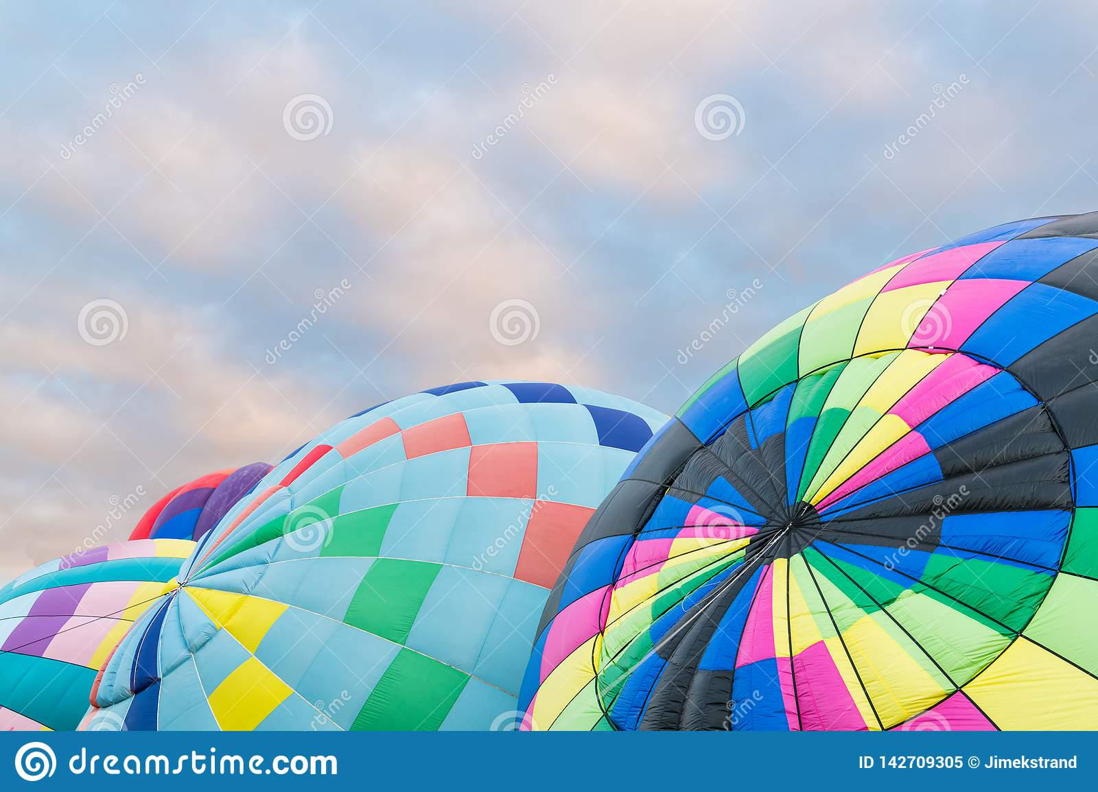 A group of colorful hot air balloons being inflated at the International Ballon Fiesta in Albuquerque, New Mexico