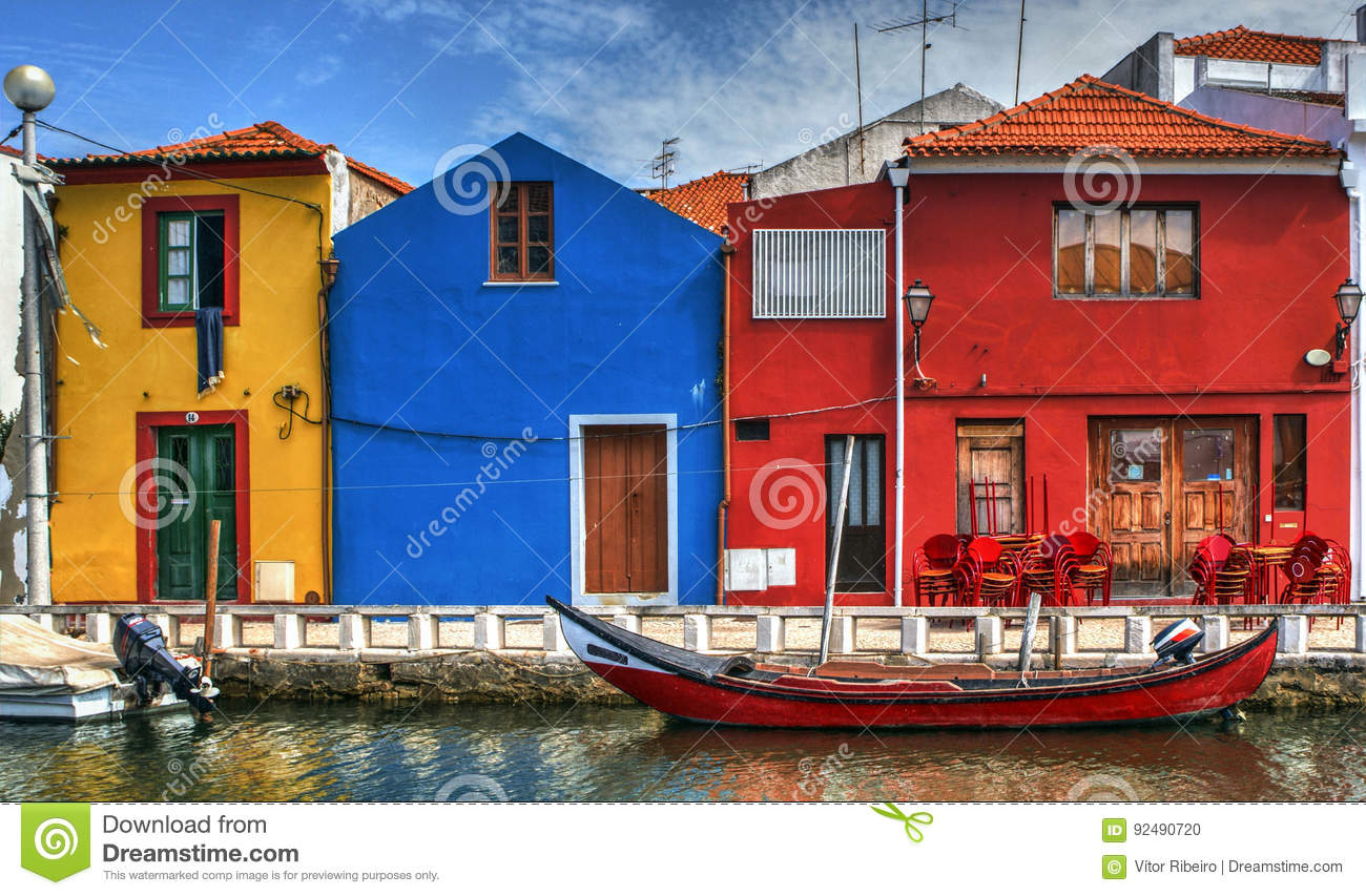 Colorful houses and typical boats in Aveiro