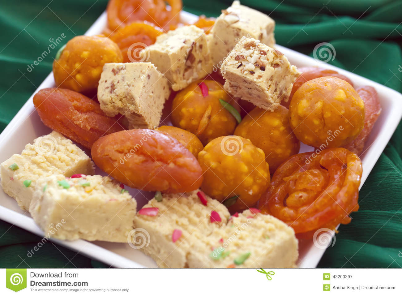Colorful Indian Diwali sweets in a plain white dish
