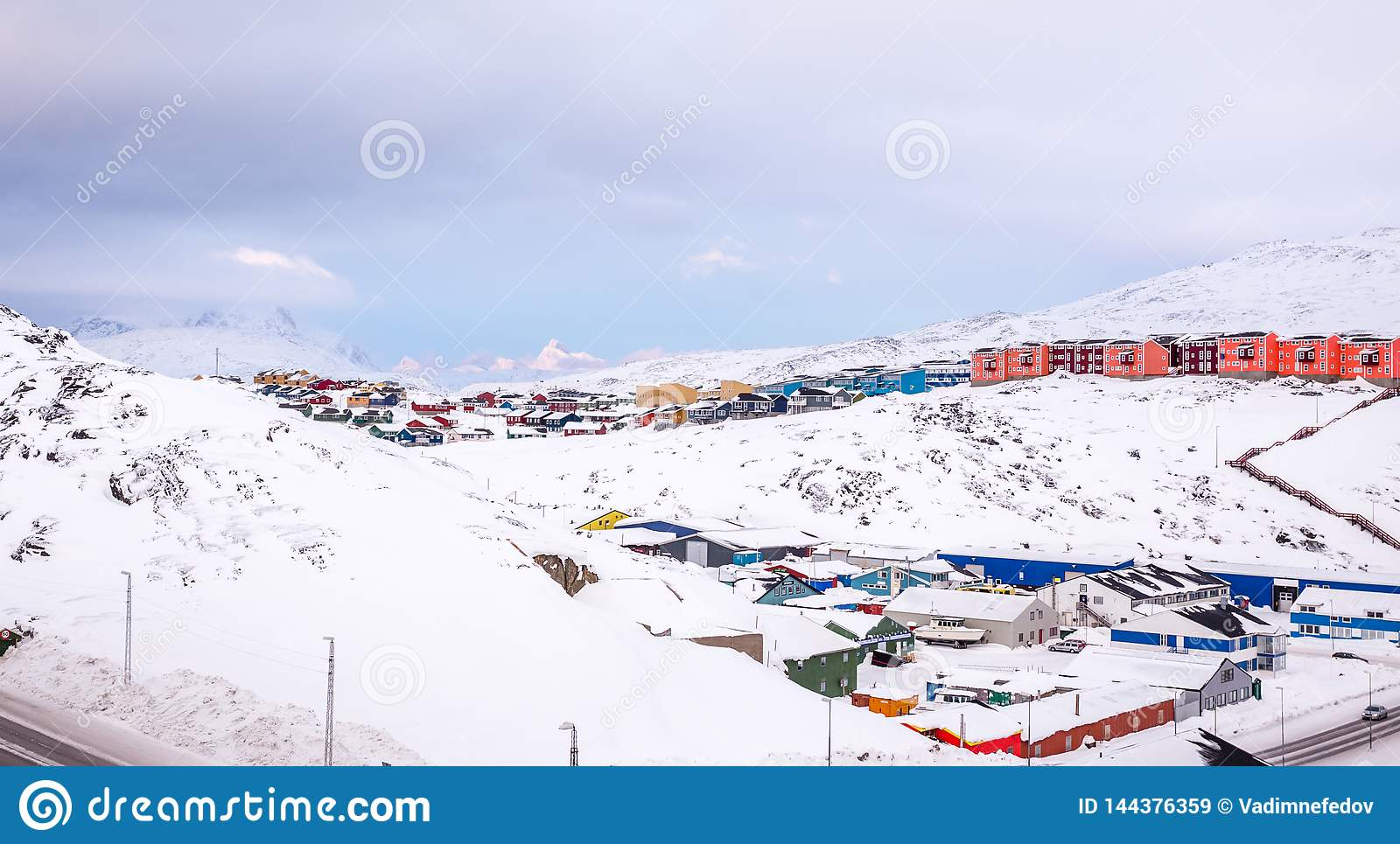 Colorful Inuit houses of Nuuk city with mountains in the background, Greenland