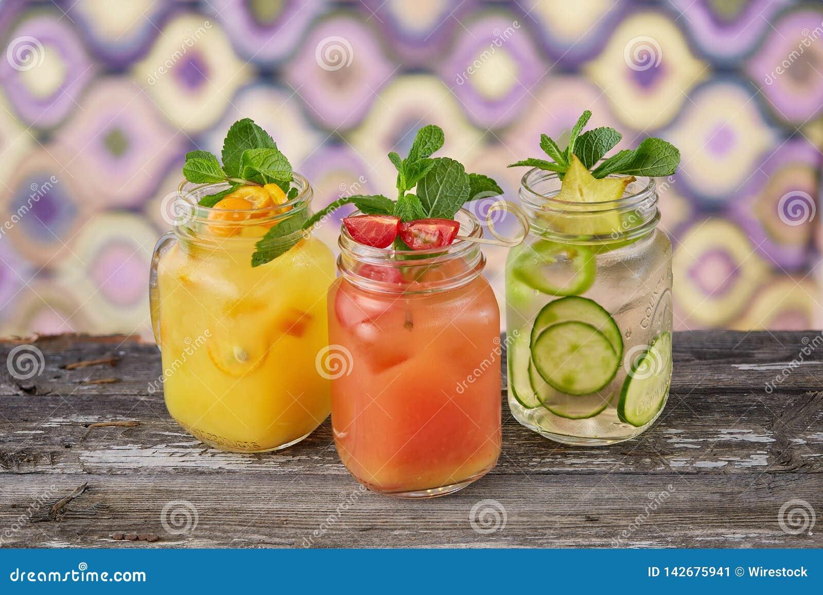 Colorful jars with lemonade
