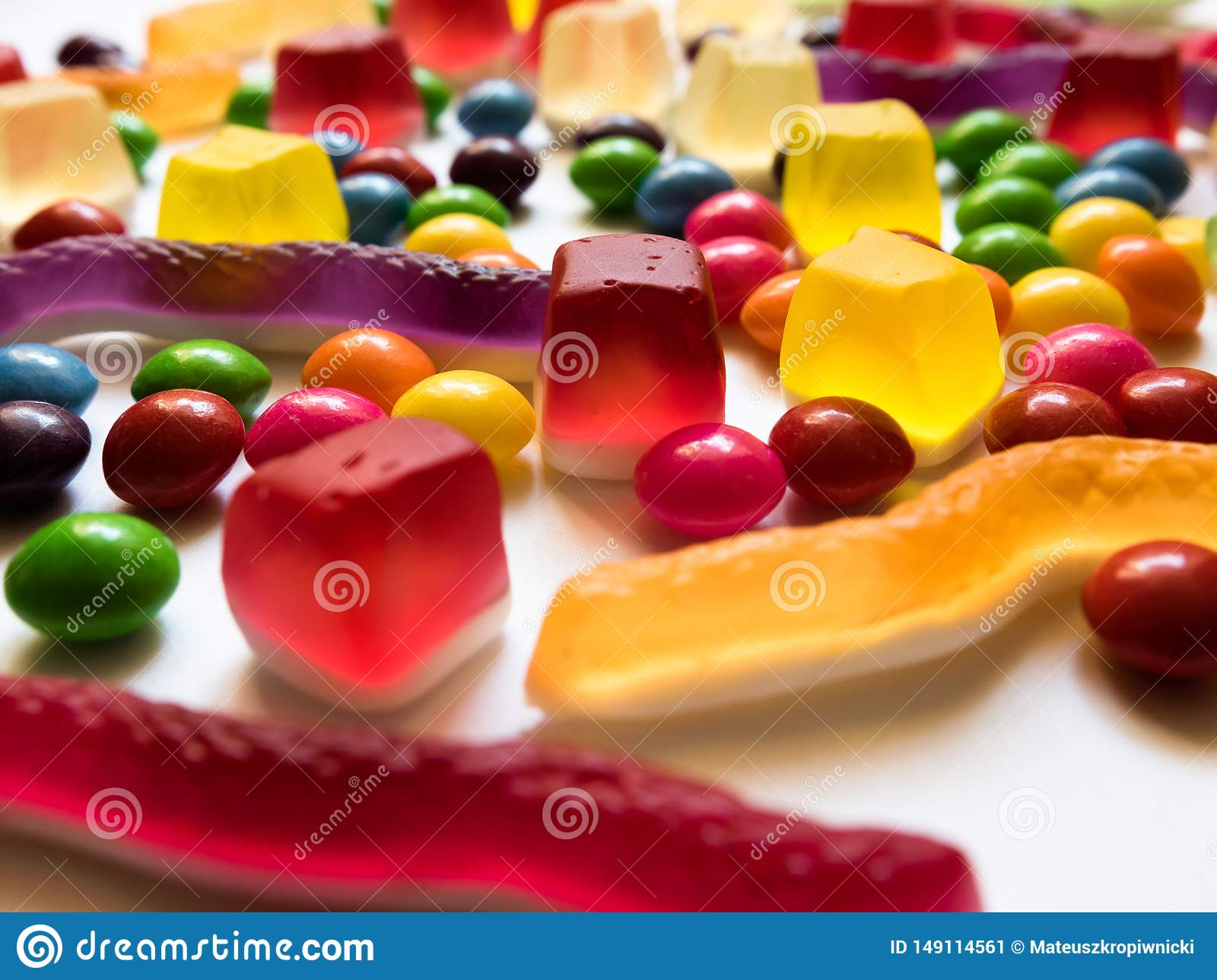 Colorful jelly and hard candies on white background