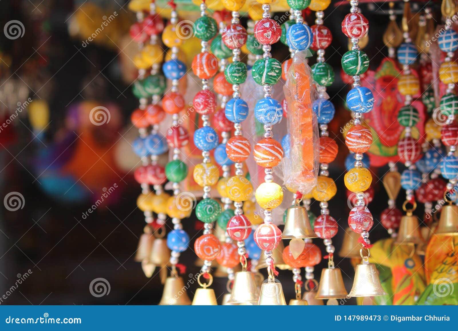 Colorful jeweler on market side