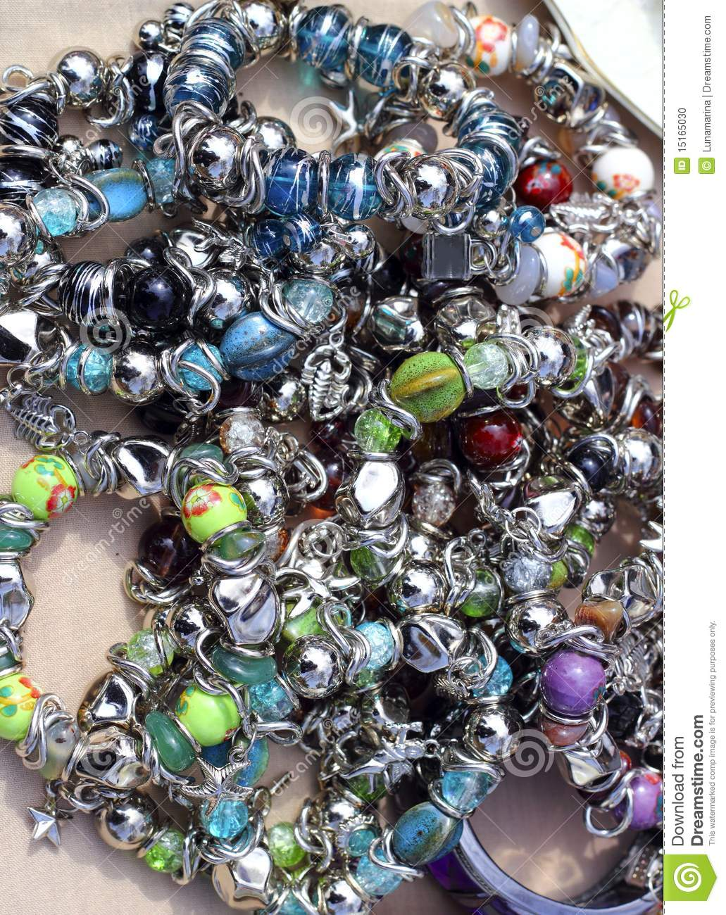 Colorful Jewelry Mess In Market Background Stock Photo ...