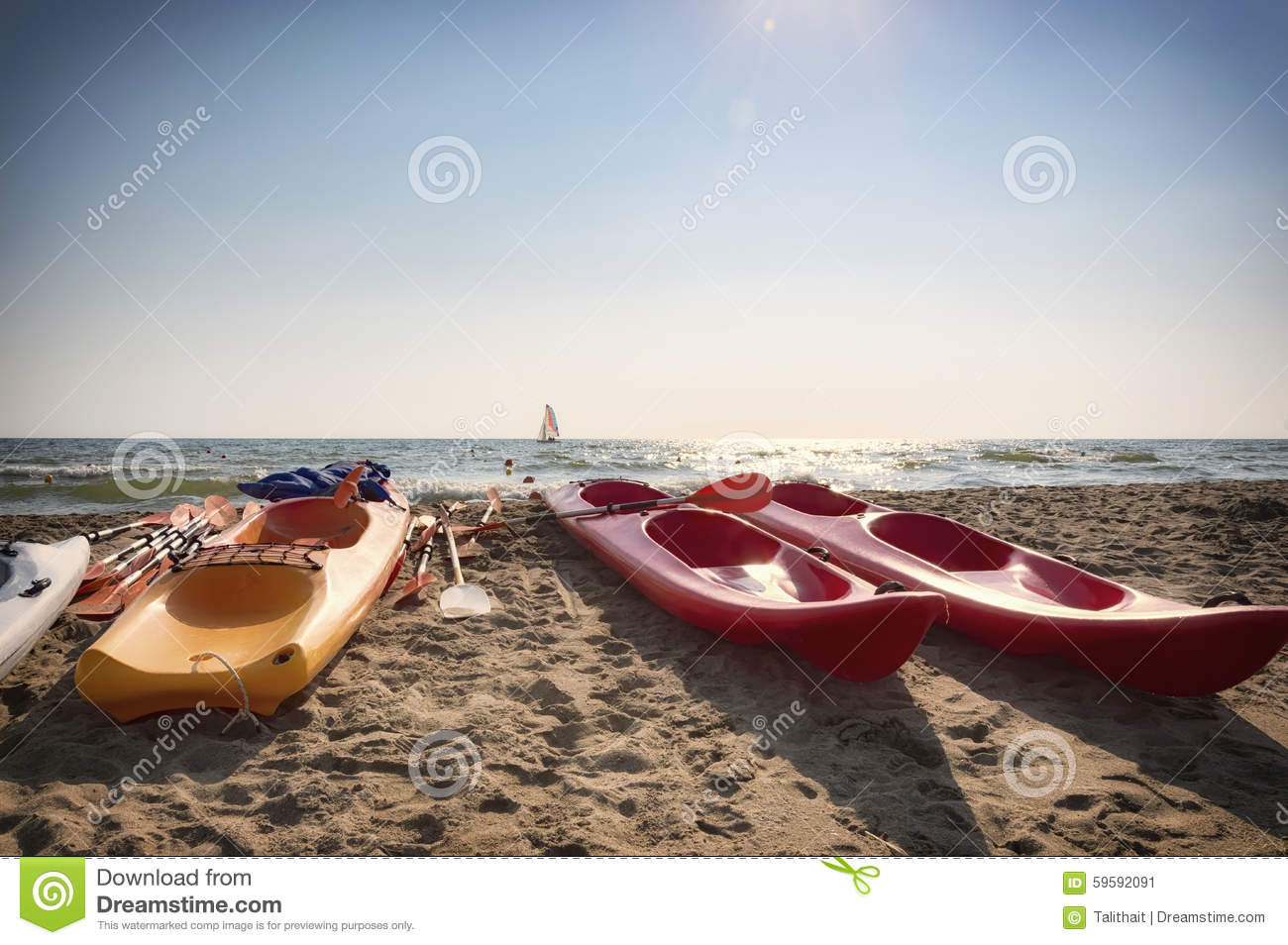 Colorful Kayak And Sailboat Stock Image - Image of italy