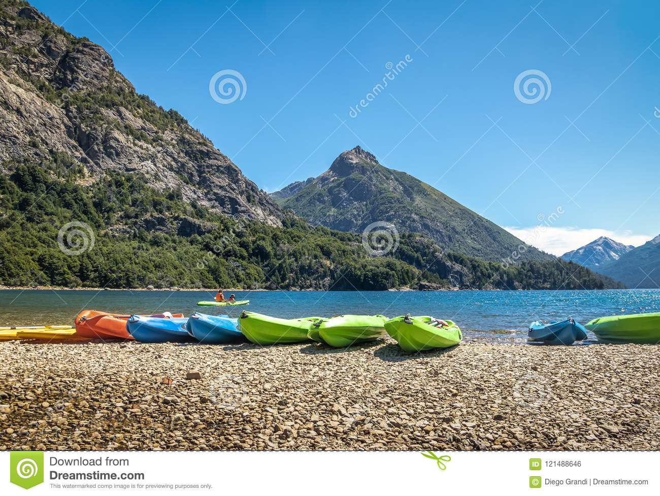 Circuito Chico Bariloche : Colorful kayaks in a lake surrounded by mountains at bahia lopez in