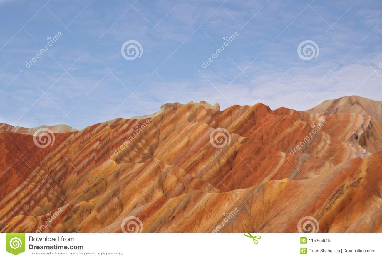 Colorful landscape of rainbow mountains and blue sky.