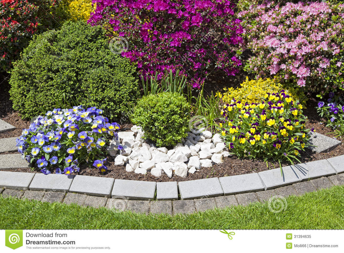 Free corner garden ideas photograph colorful landscaped fl for Flower bed arrangements