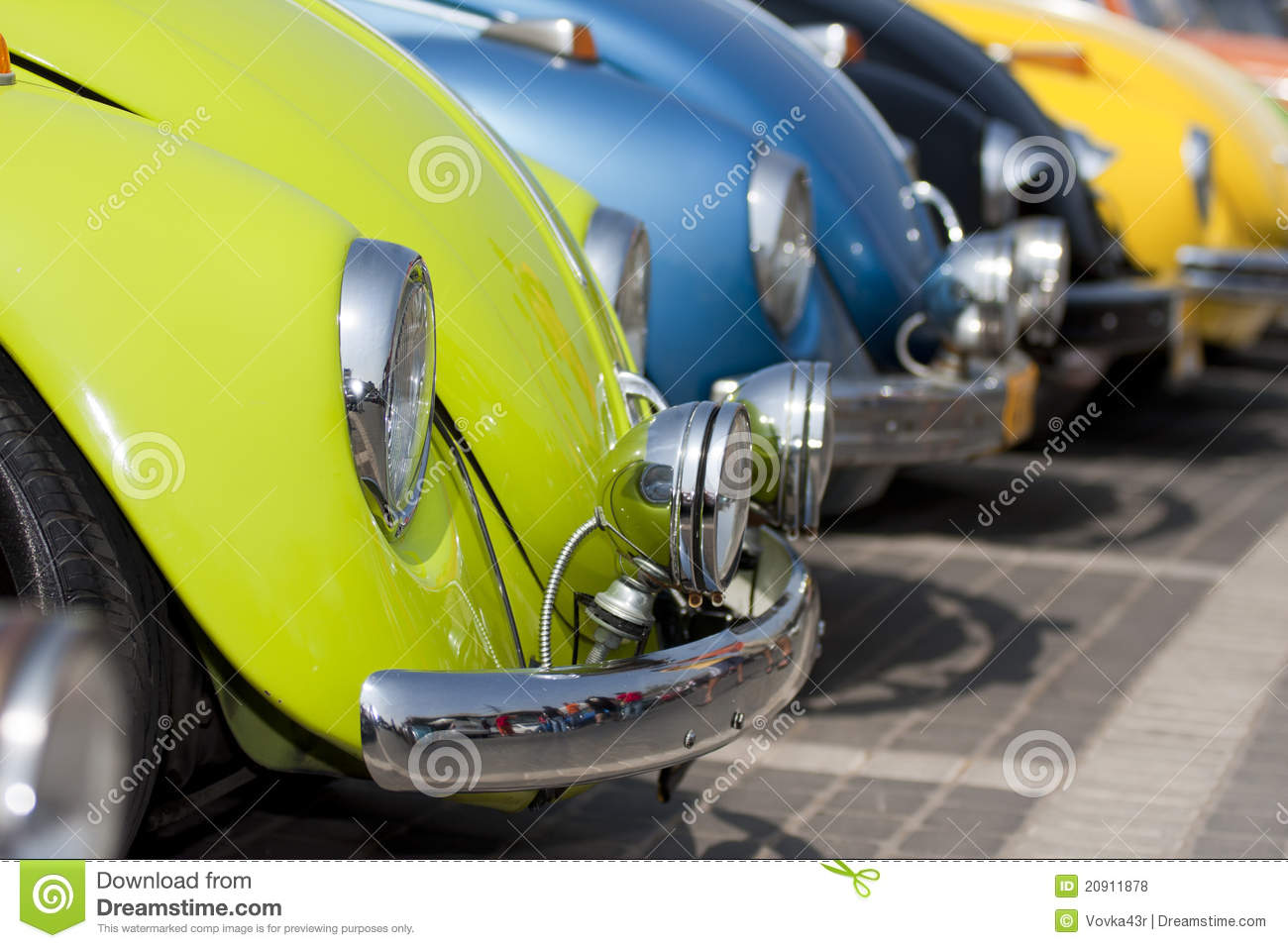 Colorful line of classic cars