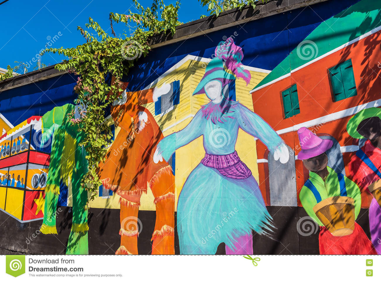Colorful local Caribbean expressionism on a wall in downtown Fr