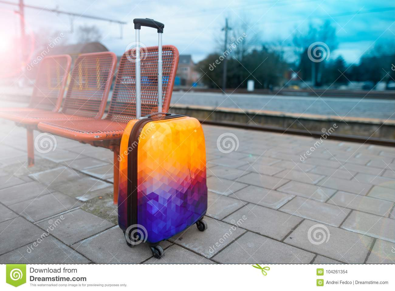 Colorful luggage near the railroad. Railway station. Ready to travel.