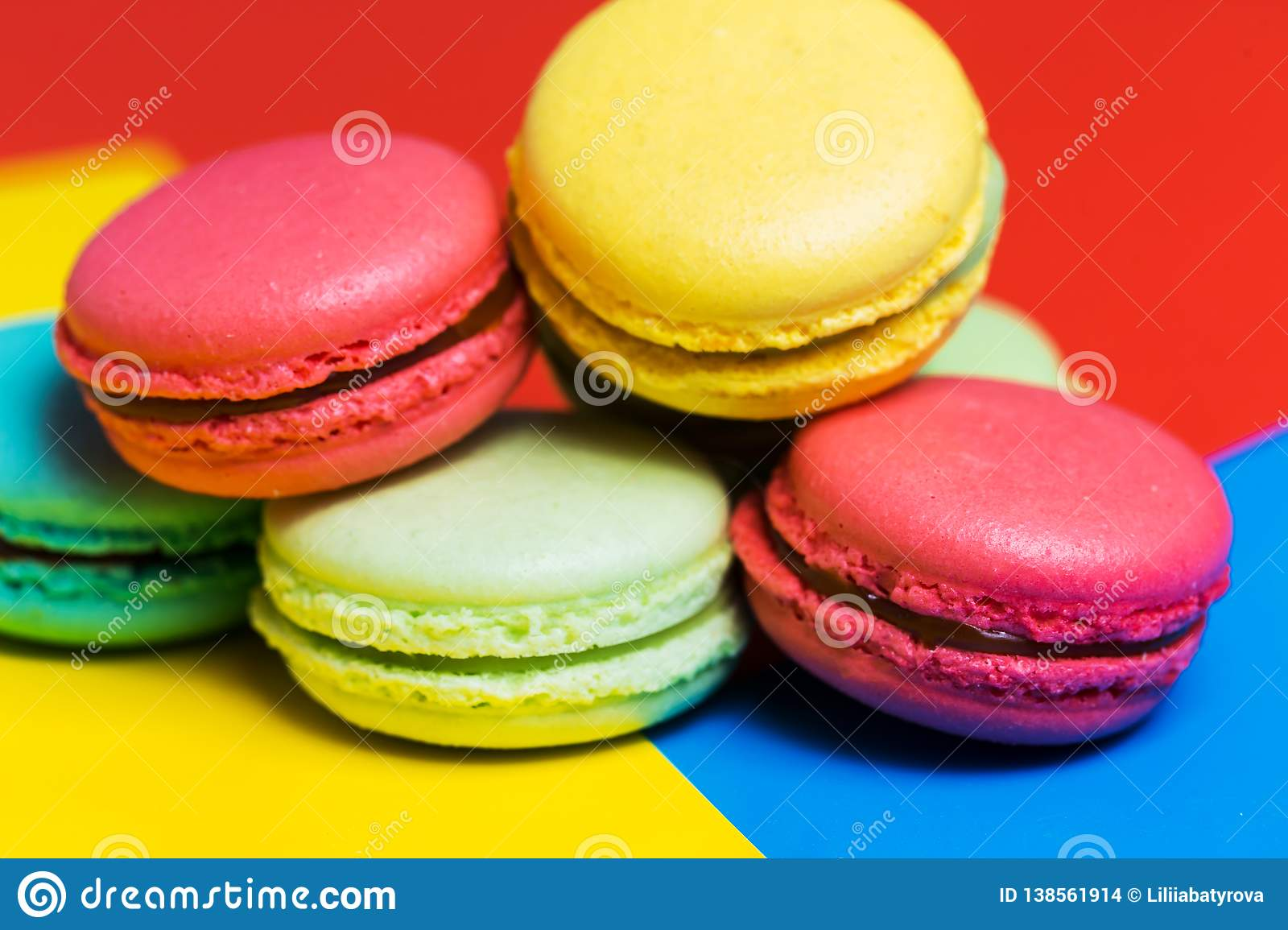 Colorful Macarons Cakes On A Blue Background Closeup Pink Yellow Green French Dessert Stock Photo Image Of French Bake 138561914