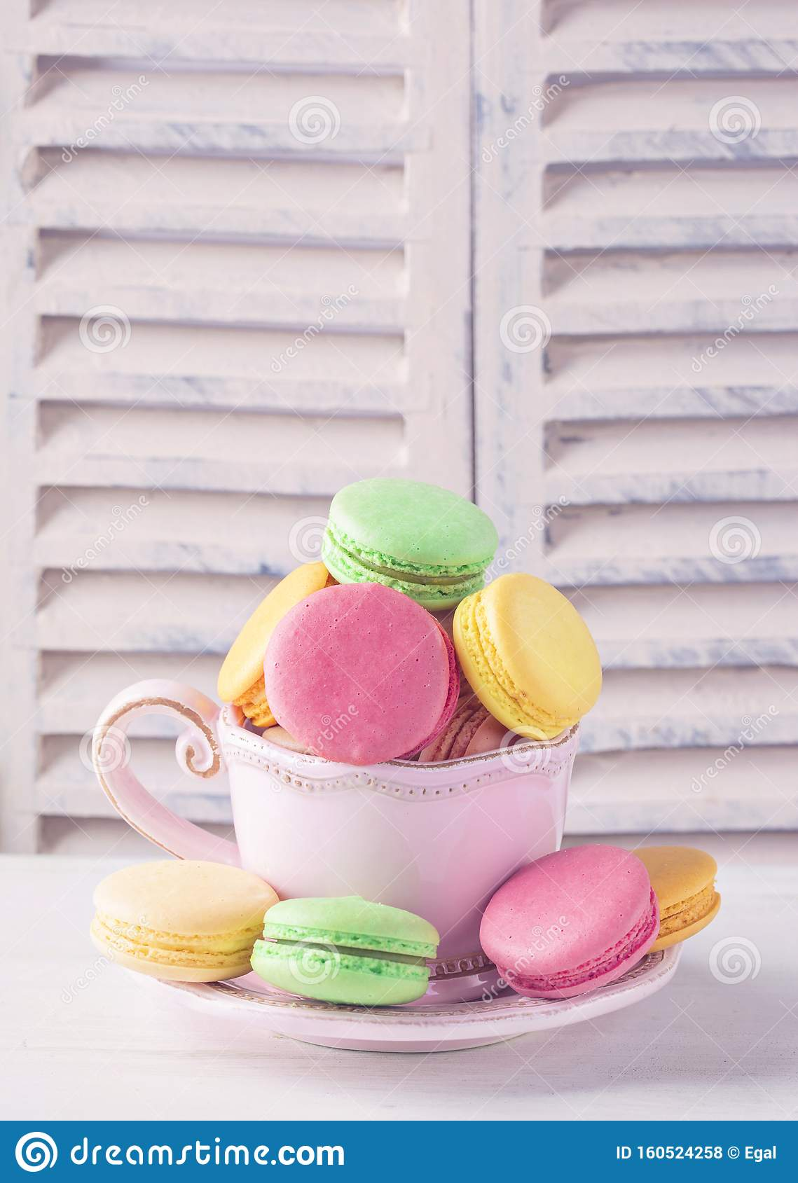Colorful macarons in a cup