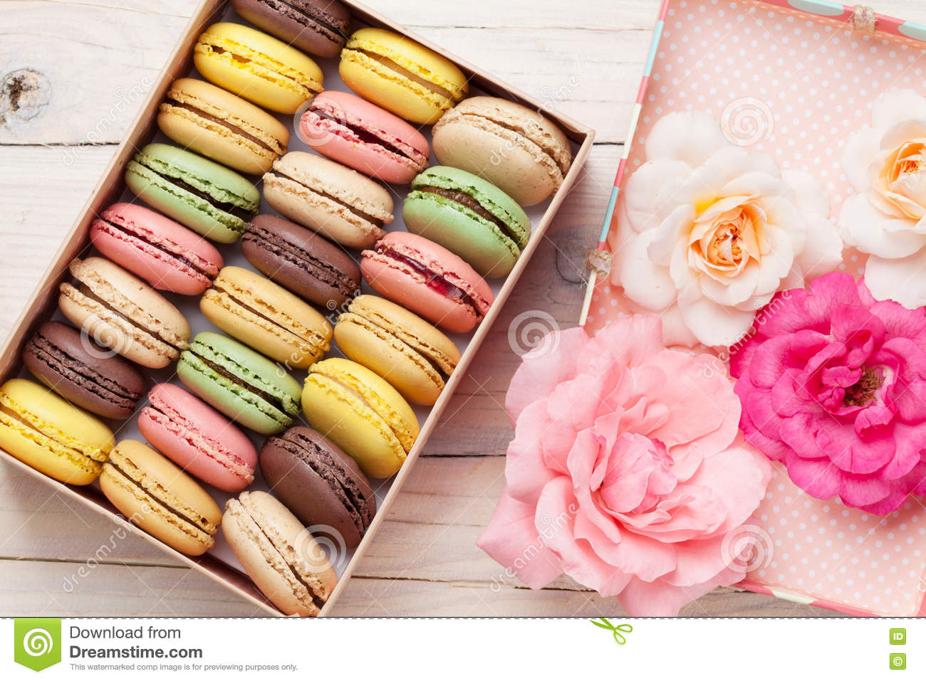 Colorful Macaroons In A Gift Box And Roses Stock Photo - Image ...